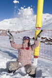 Snowboarder in ski resort. Image of snowboarder playing with snow Royalty Free Stock Image
