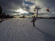 Snowboarder on the ski slope Stock Photo