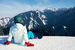 Snowboarder on ski slope. In winter mountains Royalty Free Stock Images