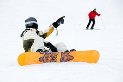 Snowboarder and skier Royalty Free Stock Images