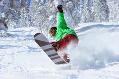 Snowboarder skier jumps freeride forest. Snowboarder jumps in forest freeride in powder. Sheregesh ski resort Stock Images