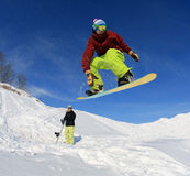 Snowboarder in the sky. Jumping snowboarder against the blue sky Royalty Free Stock Photography