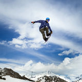 Snowboarder in the sky Royalty Free Stock Images