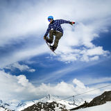 Snowboarder in sky Stock Images