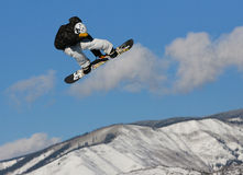 Snowboarder in the sky. Royalty Free Stock Images
