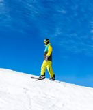 Snowboarder sliding down the hill, snow mountains Stock Images
