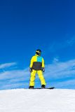 Snowboarder sliding down the hill, snow mountains Stock Photos