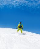Snowboarder sliding down hill, snow snowboarding Stock Photo