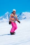 Snowboarder sliding downhill Stock Images