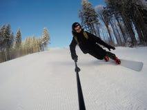 Snowboarder on the slope. Man snowboarder on the slope on ski resort Bukovel Stock Images
