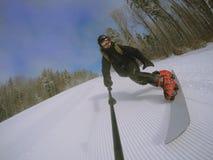 Snowboarder on the slope. Man snowboarder on the slope on ski resort Bukovel Royalty Free Stock Photo
