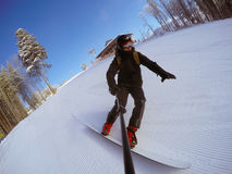 Snowboarder on the slope. Of ski resort Bukovel Royalty Free Stock Photography