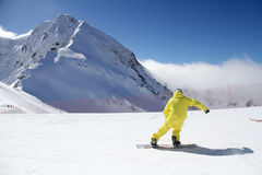 Snowboarder on the slope. Royalty Free Stock Photos