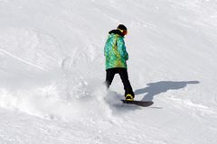 Snowboarder on the slope Stock Images