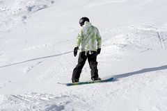 Snowboarder on the slope Royalty Free Stock Image