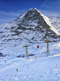 Snowboarder on the slope at winter sport resort in swiss alps Stock Photography