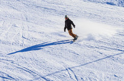 Snowboarder on the slopes Stock Photo