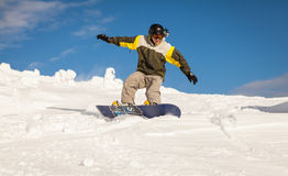Snowboarder on the slopes Royalty Free Stock Photos