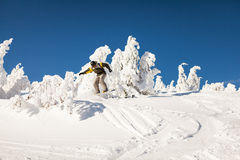 Snowboarder on the slopes Royalty Free Stock Photo