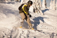 Snowboarder on the slopes Royalty Free Stock Image