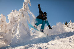 Snowboarder on the slopes Royalty Free Stock Photography