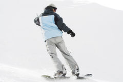 Snowboarder on snow Stock Image