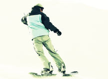 Snowboarder on snow Stock Photo