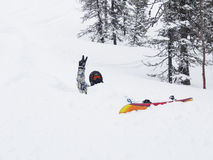 Snowboarder in a snow drift Stock Photos