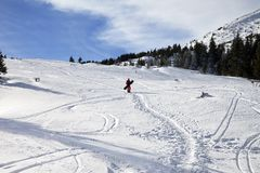 Snowboarder on snow off-piste slope with snowboard in hands at s Stock Photo
