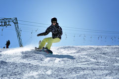 Snowboarder snowboarding down the slope in the Austrian Alps Stock Photography