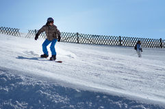 Snowboarder snowboarding down the slope in the Austrian Alps Stock Image