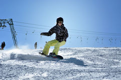 Snowboarder snowboarding down the slope in the Austrian Alps Stock Photo
