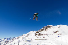 Snowboarder in snowpark. Snowboarder performing a big air in snow park Royalty Free Stock Images