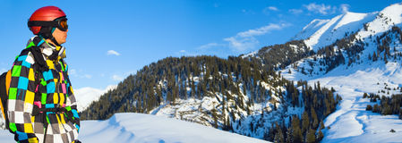 Snowboarder in the snowy mountains. Stock Images