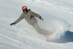 Snowboarder spritzt innen vom Schnee Lizenzfreies Stockbild