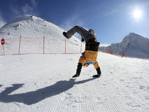 Snowboarder standing on hands Stock Image