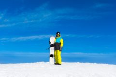 Snowboarder standing hold snowboard Stock Photos