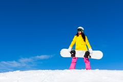 Snowboarder standing hold snowboard Royalty Free Stock Image