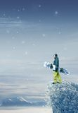 Snowboarder standing Stock Photo