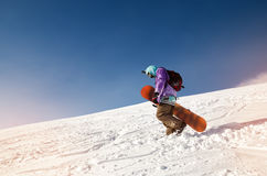 Snowboarder stands and walks on mountain slopes of an extinct volcano Elbrus Stock Photography