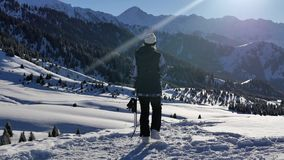 Snowboarder successful young woman adventure to snowy alps mountains, Swiss. Snowboard and ski healthy activities stock video