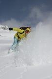 Snowboarder sulla collina Immagine Stock