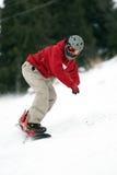 Snowboarder sur le chemin Photo stock