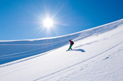 Snowboarder surfing Stock Image