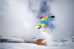 Snowboarder tail grab. Image of snowboarder jumping in Alpe d' Huez, France Stock Photography