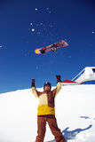 Snowboarder takes the board up Stock Photo