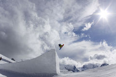 Snowboarder taking big air jump Royalty Free Stock Images