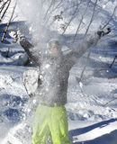 Snowboarder throwing snow in the mountains Stock Photo