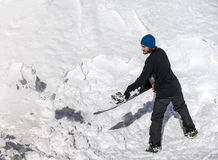 Snowboarder throws snow snowboard Stock Photography