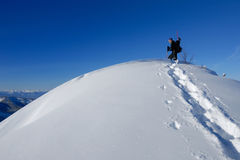 Snowboarder on the top of hill stock images
